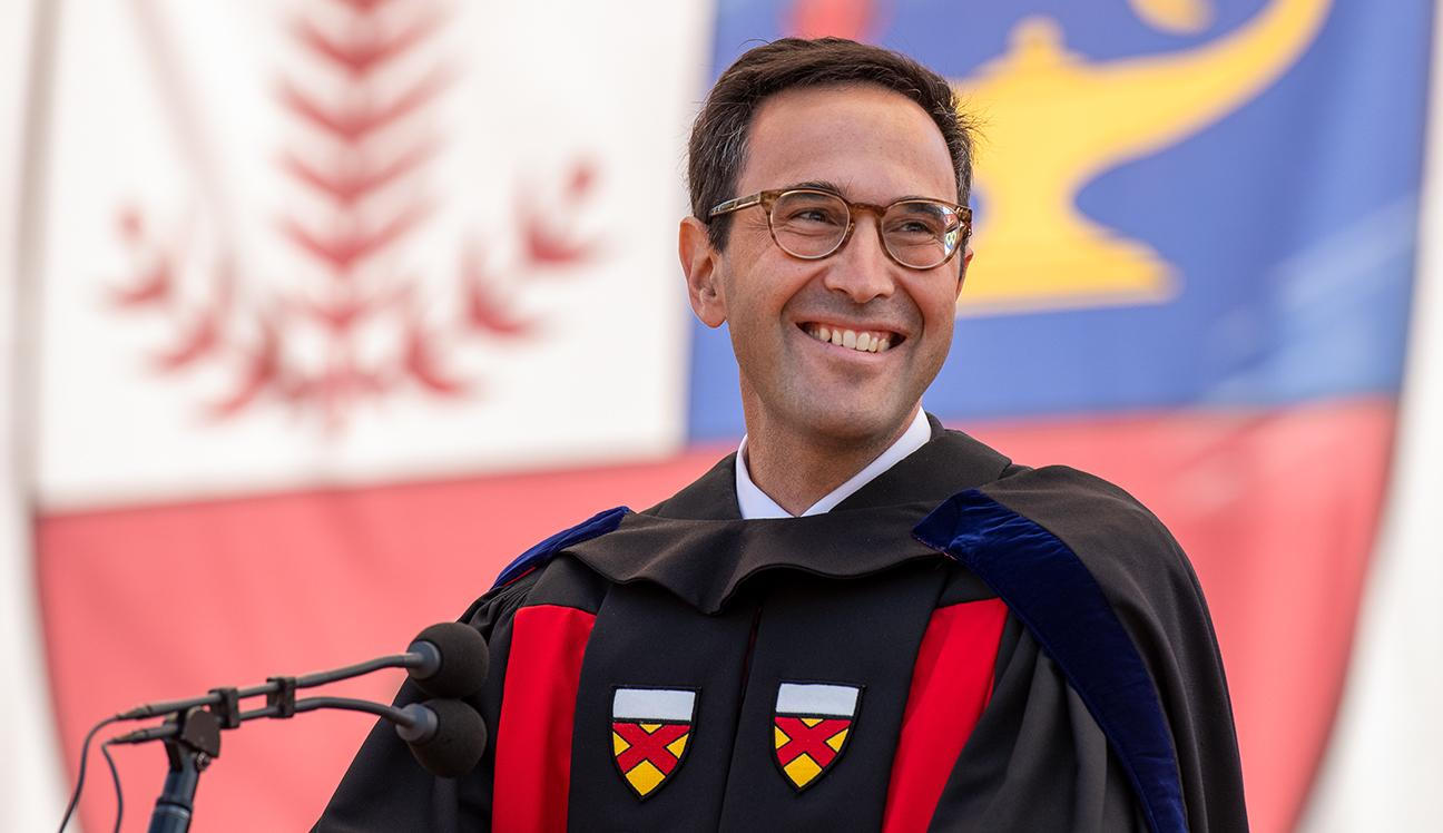 Dean Jon Levin speaking at a commencement ceremony